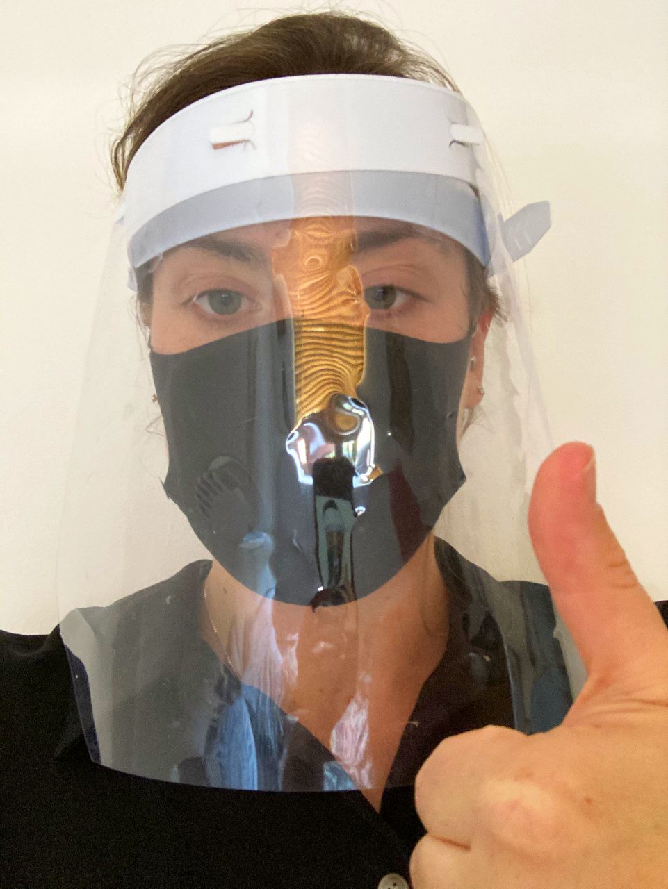 A makeup artist in full PPE for covid protection.