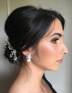 A beautiful dark-haired bride with elegant makeup and hairstyle.