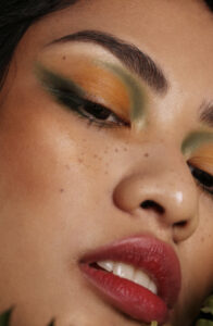 Fashion model with coloured makeup.